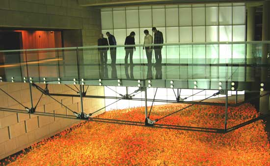 "A recreated Western front poppy field, reminiscent of the famed John McCrae poem, ""In Flanders Field,"" represents thousands of dead combatants."