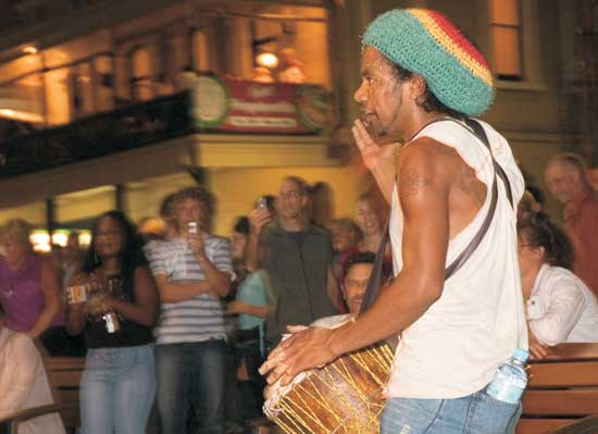 A drummer entertains the crowds at the Adelaide Fringe Festival in South Australia. Photo by SATC