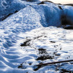 Volcanic ash and blue ice swirled together on the Sólheimajökull glacier
