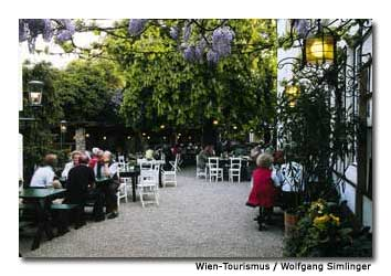 Locals enjoy a quiet evening at a Viennese wine garden.