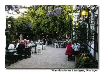 Locals enjoy a quiet evening at a Viennese wine garden.