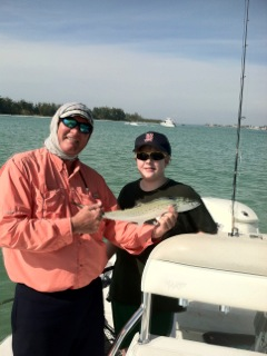 Captain Terry and Kyle Stukel with a Speckled Trout in Siesta Key, Florida