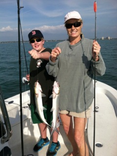 Kyle and Lisa (author) show off their Ladyfish, after a hard-fought struggle.