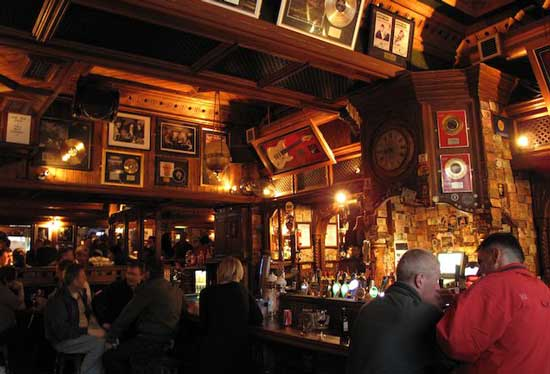 Framed gold and platinum records and other rock n' roll memorabilia lines the wood-paneled walls of The Foggy Dew, a popular pub in Dublin's Temple Bar district. Photo by Amy Laughinghouse