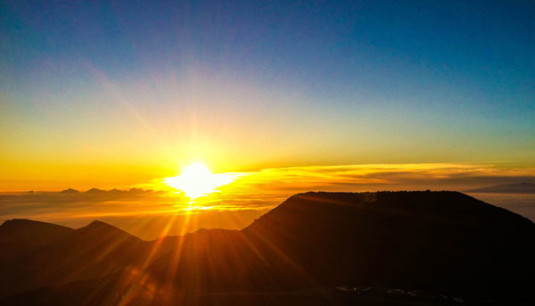Viewing the sunrise from Haleakala, the massive shield volcano that forms more than 75 percent of the Hawaiian island of Maui. Photo by Gina Kremer.