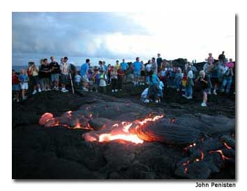 A surface lava pool attracts visitors at Hawai`i Volcanoes National Park.