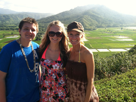 The author with two of her children at the Hanalei Valley Lookout Point.