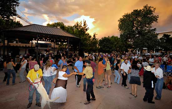Locals dance and celebrate in Santa Fe's historic plaza. Photo by Richard Khanlian