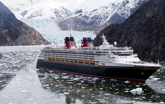 The Disney Wonder cruise ship sails past glaciers at the Tracy Arm Fjord in Alaska.