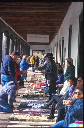 Along the border of the plaza next to the Palace of the Governors local Native Americans sell beautiful artwork, jewelry and pottery.