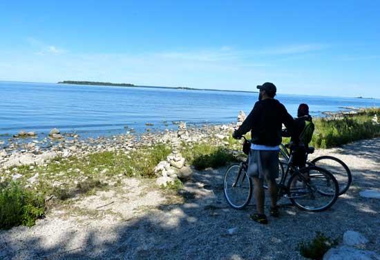 Bikers overlooking the water