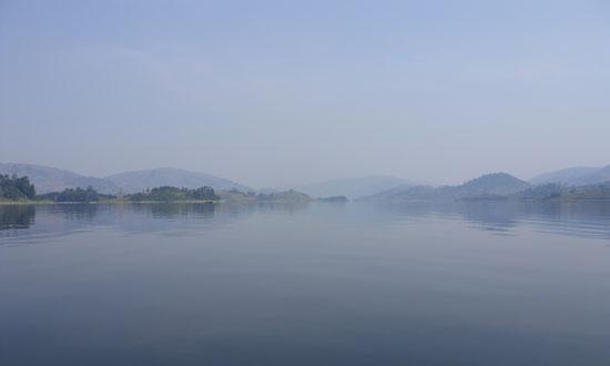 A mist settles over Lake Bunyoni's glass-like water. Photo by Alex Jones