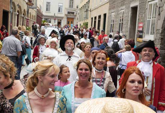 I can't help but laugh as my friends and I take part in the New France Festival Parade. Photo by Bill King