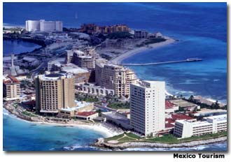 High-rise buildings line the white-sand beaches of Cancún Island.