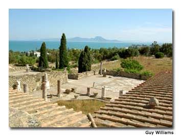 The azure waters of the Mediterranean can be seen from the rooftop terrace of a restored Roman villa in Carthage.