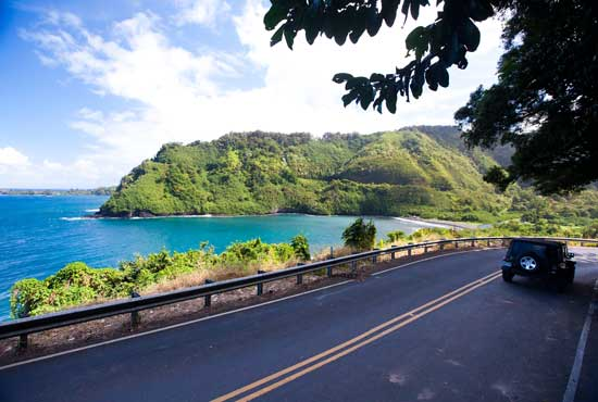 Driving on the road to Hana with beautiful ocean views.
