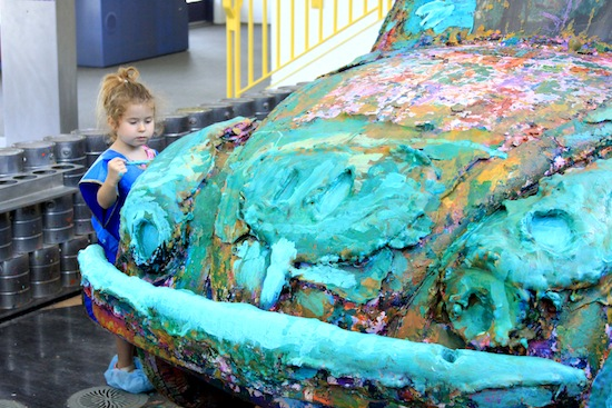 Victoria Desantis, 4, concentrates on painting a VW Beetle set up just for that  purpose at the Children's Discovery Museum in Palm Springs. Photo by Rick DuVal
