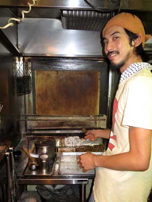 Nosuke Kurihara mans the grill, often feeling like he too is being cooked in the sweltering, smoke-filled kitchen.