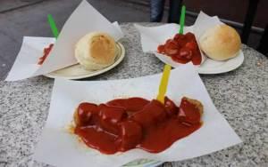Eating currywurst in Alexanderplatz. Photo by Janna Graber