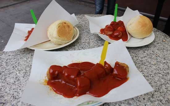 Eating currywurst in Alexanderplatz. Photo by Janna Graber