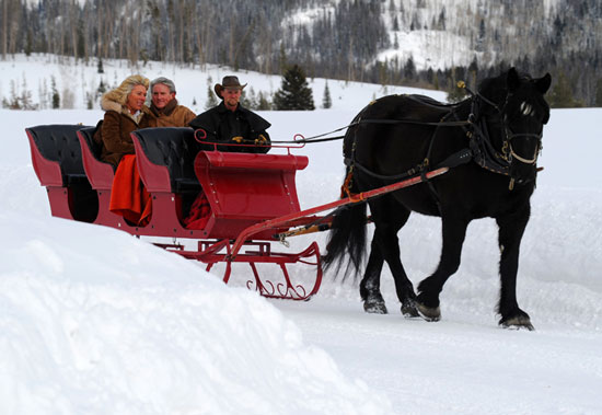 Enjoying a sleigh ride at one of Colorado's luxury dude and guest ranches. Photo by Colorado Dude & Guest Ranch Association