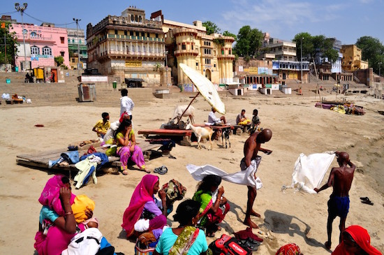 Pilgrims and devotees after a dip in the ghats of Varanasi. The city of ghats is said to be among the world's oldest continuously inhabited cities.