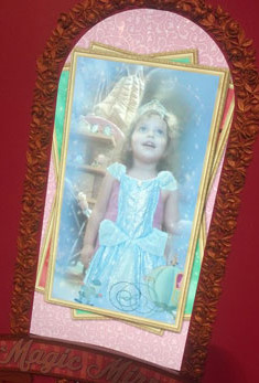 """In the """"Magic Mirror"""" little girls see their reflection dressed in Disney princess dresses."""