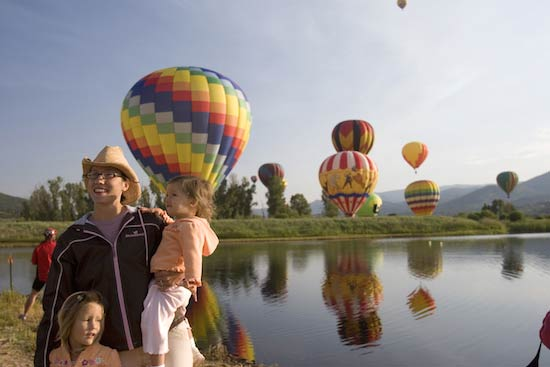 A family outing during a balloon festival in Steamboat Springs. Photo by Matt Inden/Colorado Tourism Office
