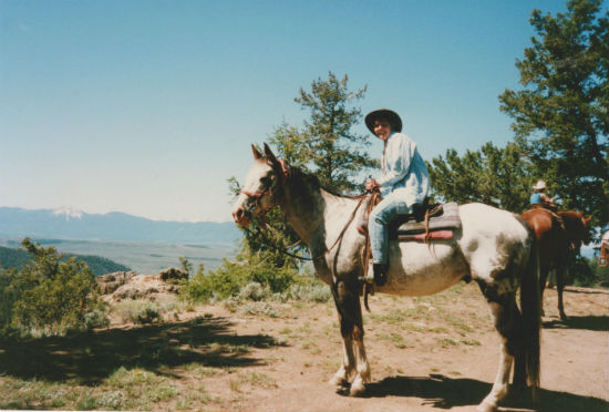 Riding horseback through Colorado is made better with boots and a cowboy hat.