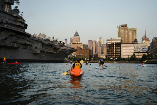 Stand up paddle boarding is an alternative to renting a kayak.
