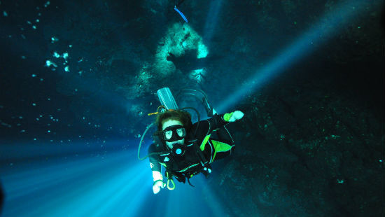 Diving in the Cenotes of the Yucatan - Natural light spill into The Pit.