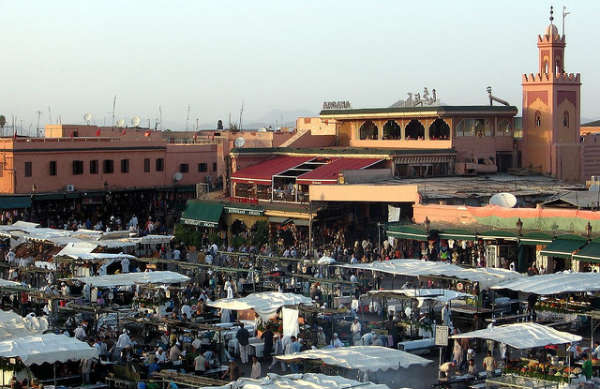 The square is filled with vendors of all kinds.