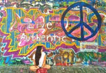 Taking a cliché picture in front of the John Lennon wall in Prague. Photo courtesy Paula Naoufal