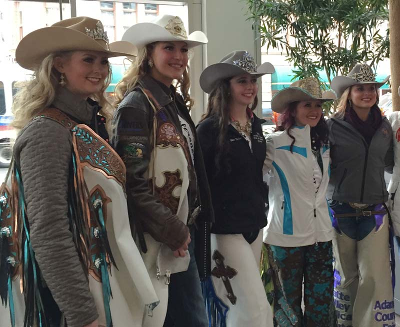 Rodeo queens from the National Western Stock Show pose for photos. Photo by Janna Graber
