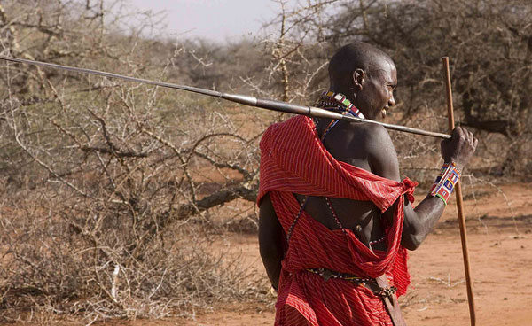 Travel in Kenya - A young Maasai man in Kenya. Flickr/gmacfadyen
