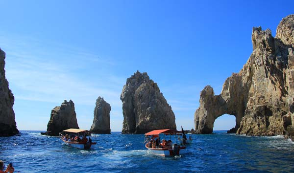 Boating past the famous arch in Los Cabos. Photo by Janna Graber
