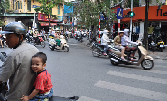 Rush hour in Hanoi is a confusing maze of traffic. Photo by Olivier Guiberteau