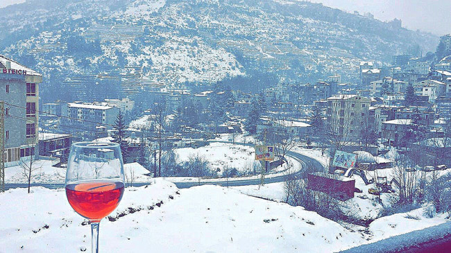 Sipping on some Rrsé wine by the snow at Mzaar. Photo by Rana Boukhari