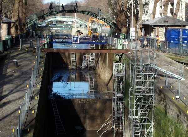 Scaffolds now fill the canal. Photo by Kevin McGoff