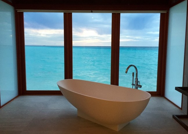 The bathroom in this villa at Anantara Dhigu in the Maldives features floor to ceiling windows. Photo by Janna Graber
