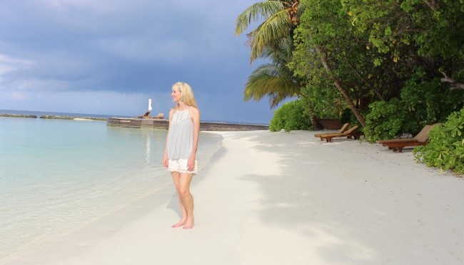 Travel journalist Janna Graber on the beach behind her villa at Baros Maldives.