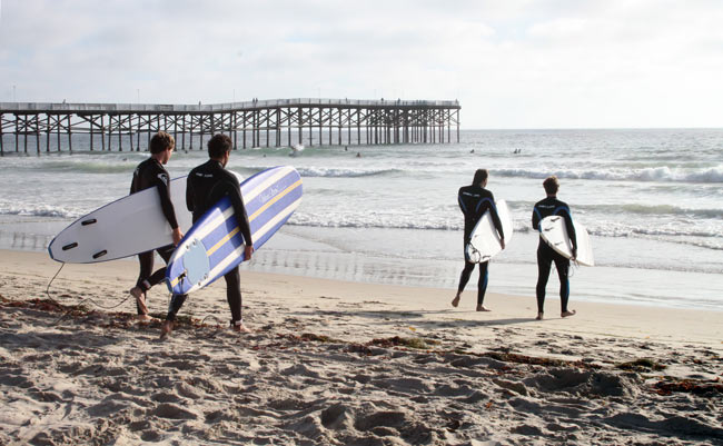 Surfers near Pacific Beach at Crystal Pier. Photo by Joanna DiBona