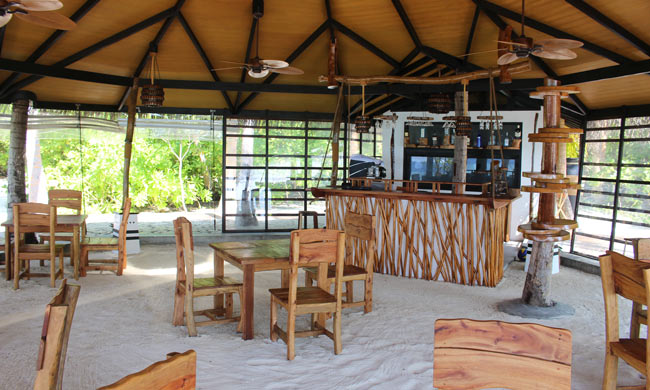 Open-air bar at AaaVeee in the Maldives. Photo by Janna Graber