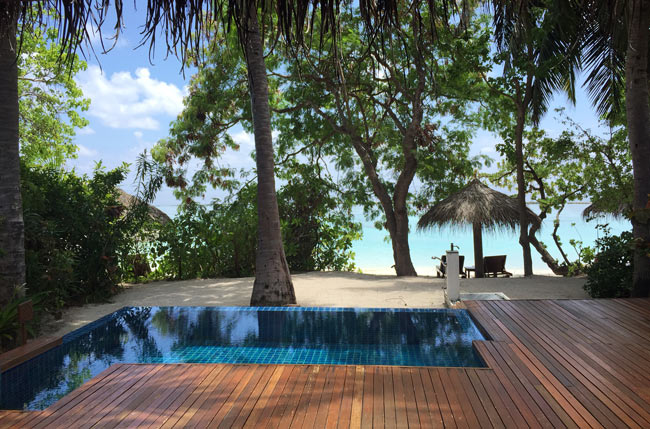 The private deck behind the author's villa at Baros, with plunge pool and beach access. Photo by Janna Graber