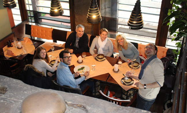 Our small group poses for a photo while dining at Restaurant Zvonice in Prague. Photo by Benjamin Rader
