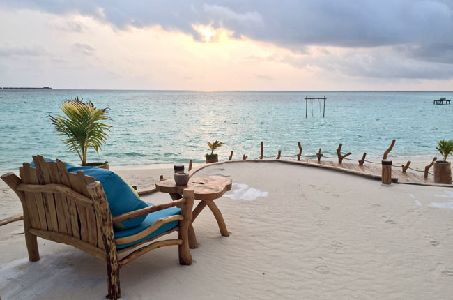 Watching the sun set at AaaVeee in the Maldives. Photo by Janna Graber