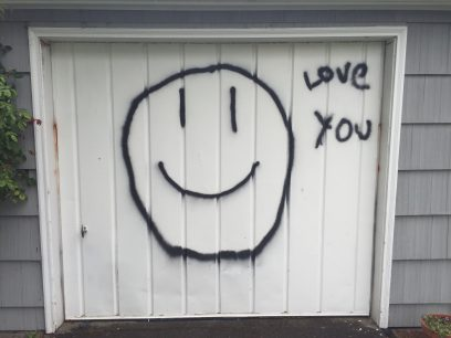 Neil told me on the phone that I would know I was at the correct house because there would be a large smiley face painted on the garage door.