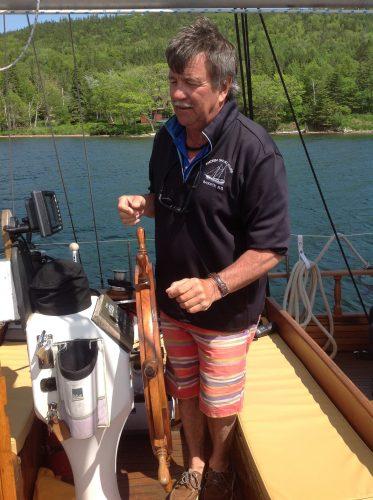 Captain John sails the Amoeba Schooner. Photo by