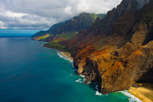 This fifteen-mile stretch of coastline is located on the northwest shore of Kauai. Much of Na Pali Coast is inaccessible due to its characteristic sheer cliffs that drop straight down into the ocean.This fifteen-mile stretch of coastline is located on the northwest shore of Kauai. Much of Na Pali Coast is inaccessible due to its characteristic sheer cliffs that drop straight down into the ocean.