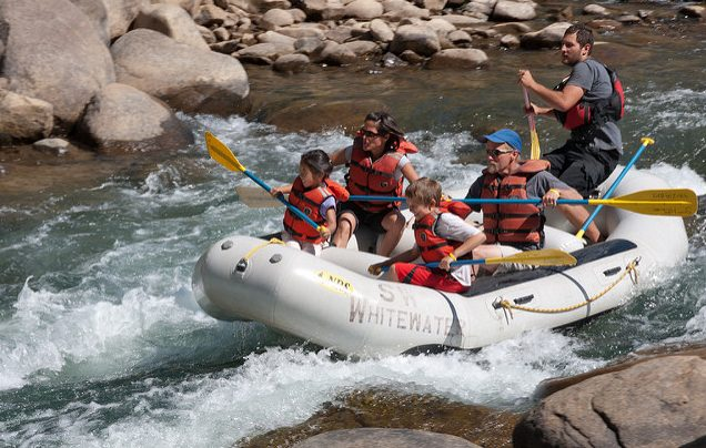Rafters navigate the rapids in Durango, CO. Flickr/Tony